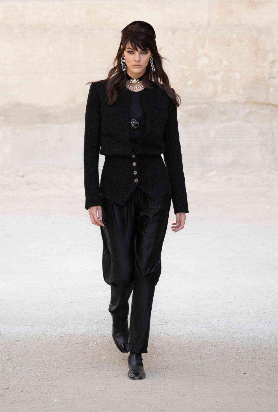 Vittoria Ceretti is wearing a new feminine interpretation of the tweed jacket worn with fluid jodhpurs and patent glove booties
