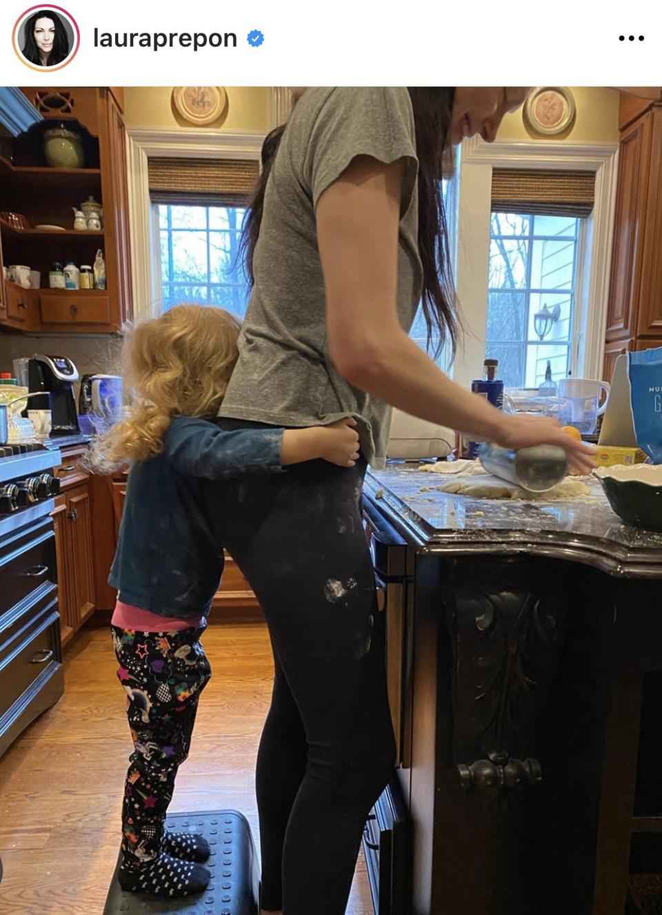 A photo from Laura Prepon's Instagram of her cooking with her daughter for Thanksgiving 2020