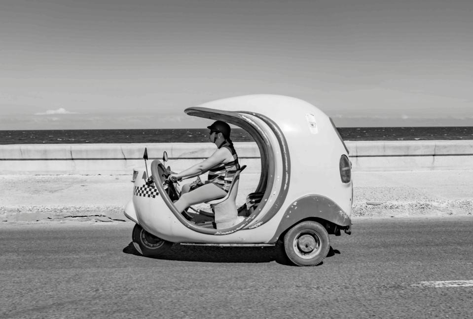 A tuk tuk on the streets of Cuba
