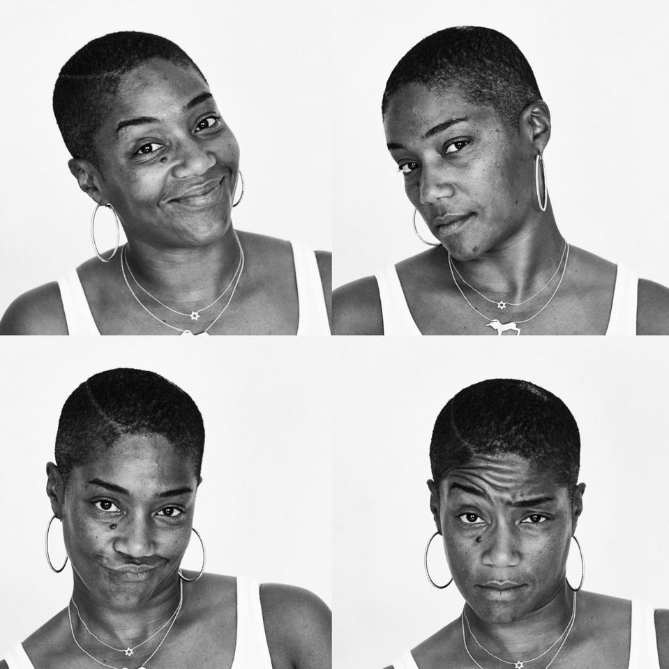 Four black and white portraits of Tiffany Haddish. She is in a white tank top, wearing a pair of large hoop, and two necklaces, one with the Star of David and the silhouette of a unicorn. Haddish looks at the camera in each portrait, one in which she's smiling, in the second portrait she tilts her head to the side, the third she is scrunching up her nose, and in the final portrait she raises an eye brow.
