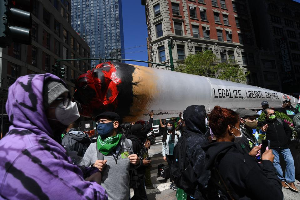 Demonstrators march in the annual NYC Cannabis Parade & Rally in support of the legalization of marijuana for recreational and medical use, on May 1, 2021 in New York City.
