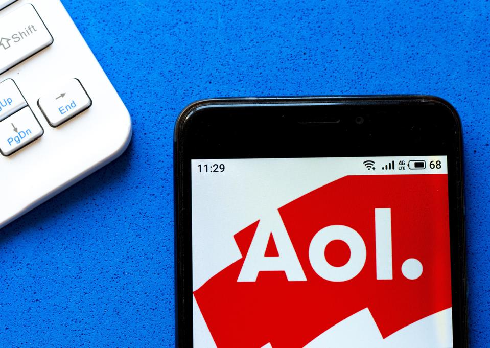 In this photo illustration an AOL logo seen displayed on a...