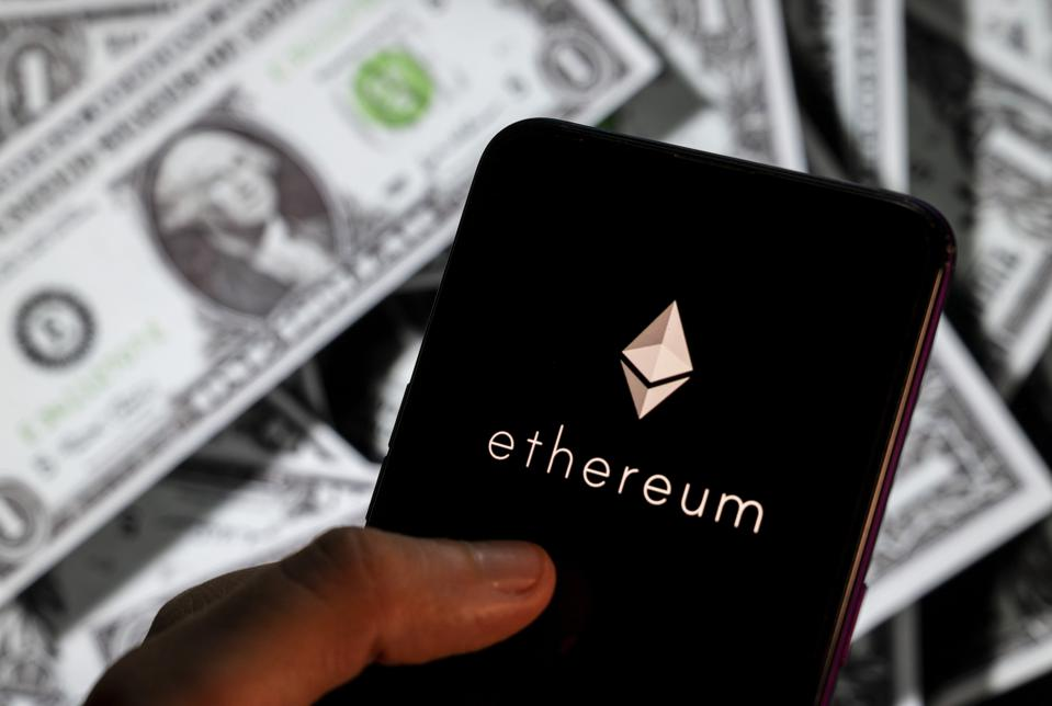 A picture of ether, a digital currency, in front of U.S. dollar bills.