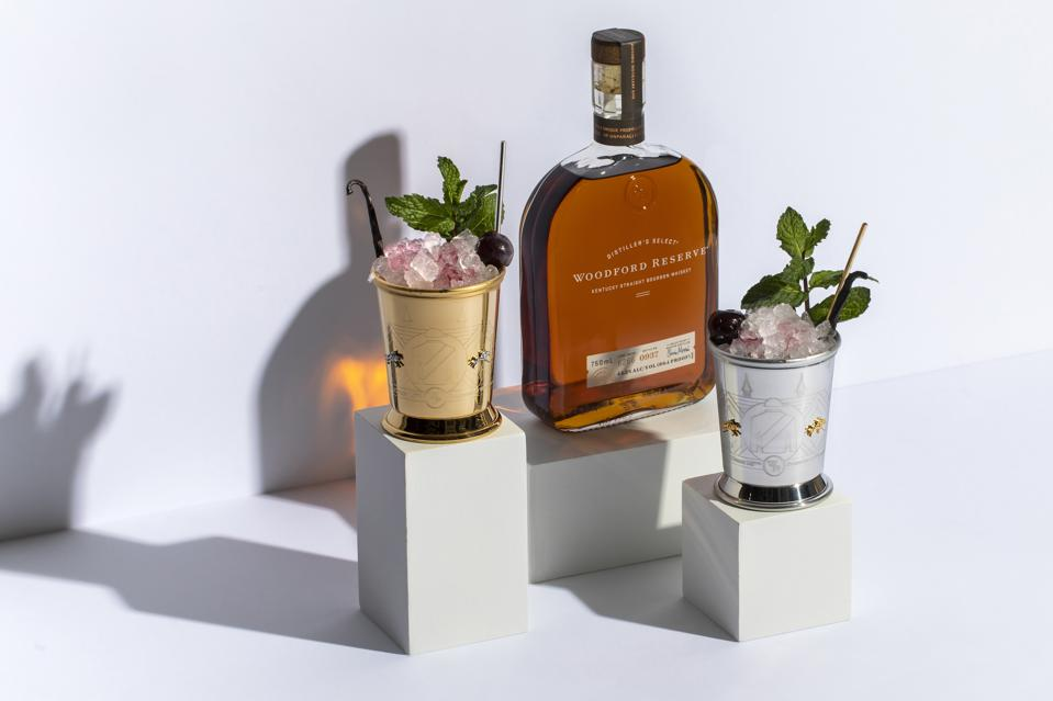Woodford Reserve sits between two beautiful cocktails.