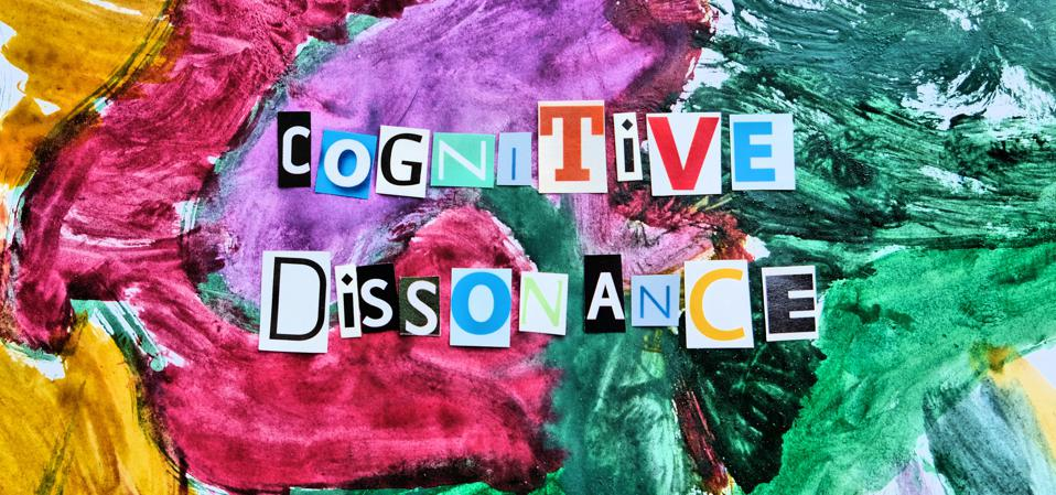 cognitive dissonance  text from  cut  letters on abstract strokes colorfull background. Headline - Cognitive dissonance, card of psychology . Psychologic concept.