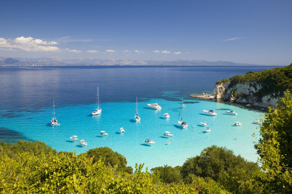 View across turquoise sea at Voutoumi Bay, Antipaxos, Greece