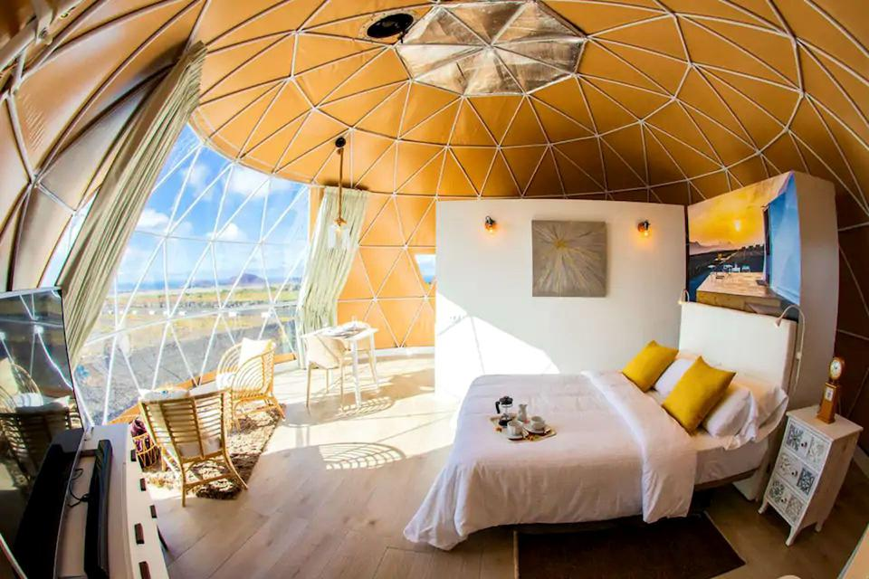 Sunlight is streaming through a clear wall of an eco dome in the Canary Islands, Spain