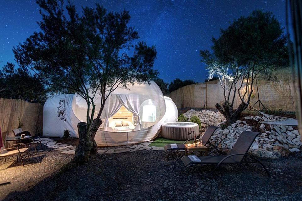 The clear glamping bubbles in Greece come with private hot tubs