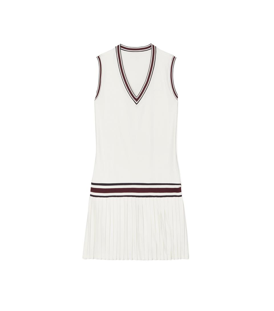 A white, v-neck tennis dress with striped details on neck and waist