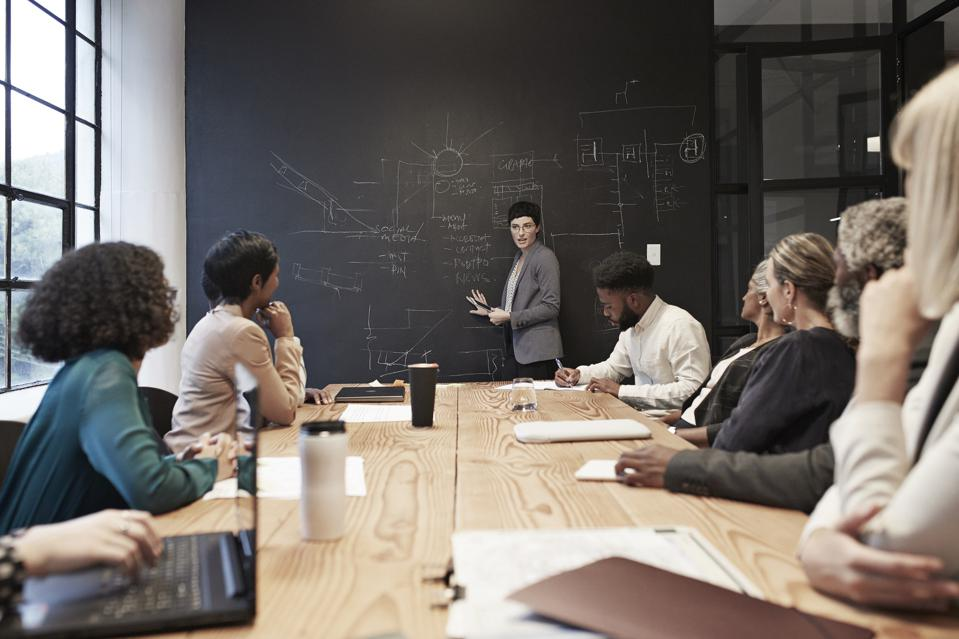Female and male coworkers in conference room during office meeting