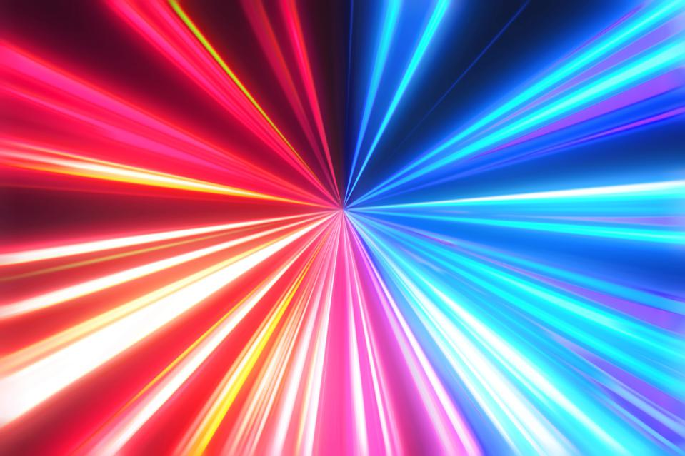 Futuristic fast lights with red and blue colors in perfect vanishing point.