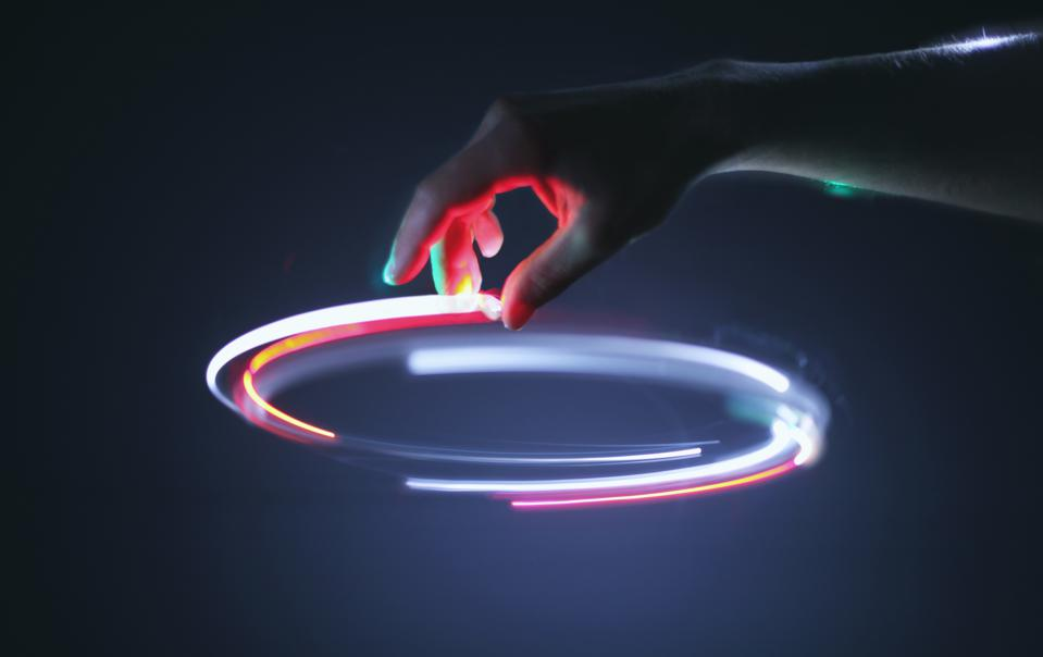 Hand controling light circle in air