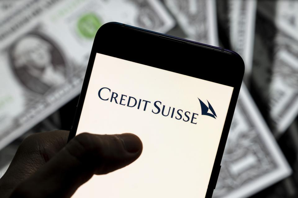 In this photo illustration, a Credit Suisse Group logo seen...