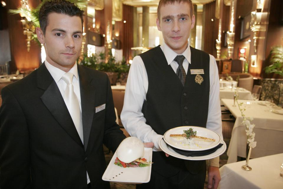 Waiters serving food at Palm Court Restaurant.