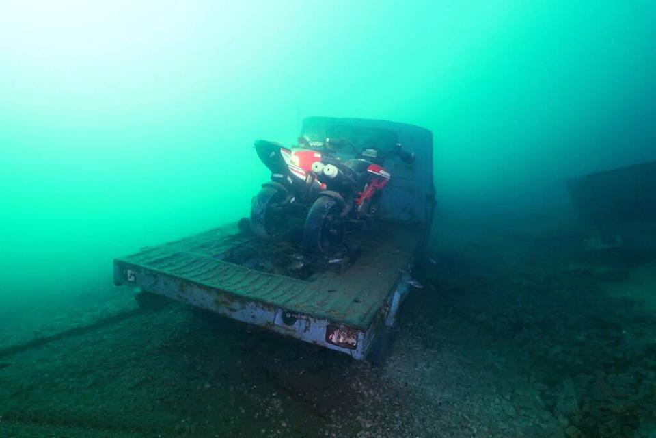 Sunken motorcyles and truck in Lake Como