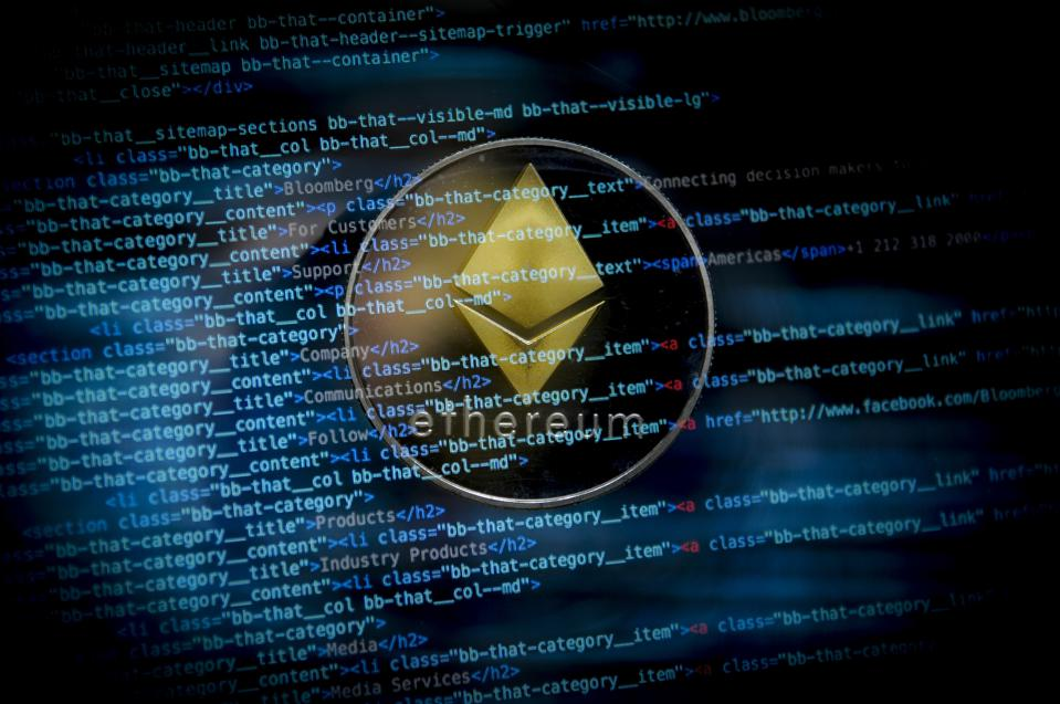 A picture of ether, a digital currency, behind computer code.