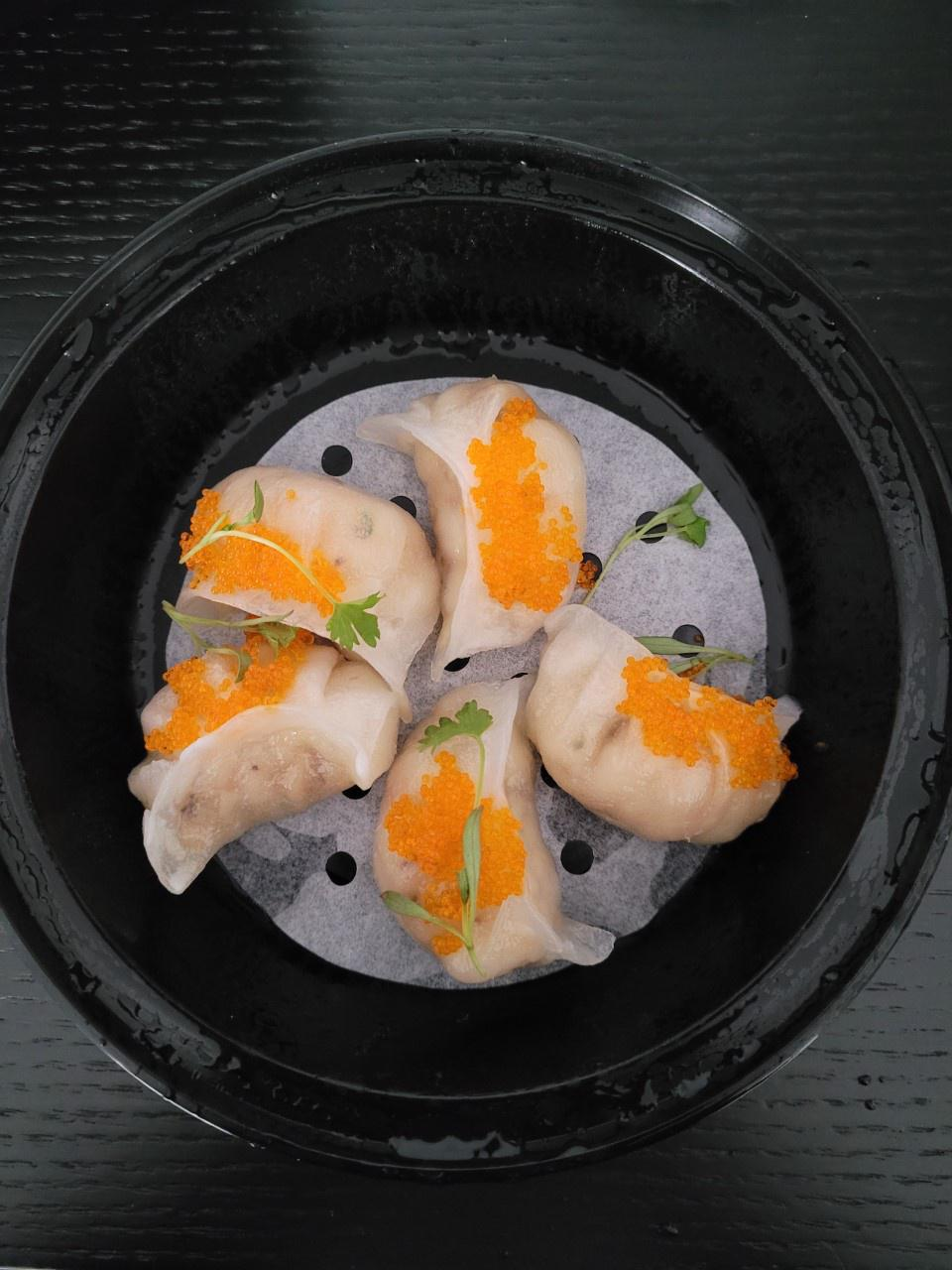 To go container with steamed dumplings with caviar from BoyChoy