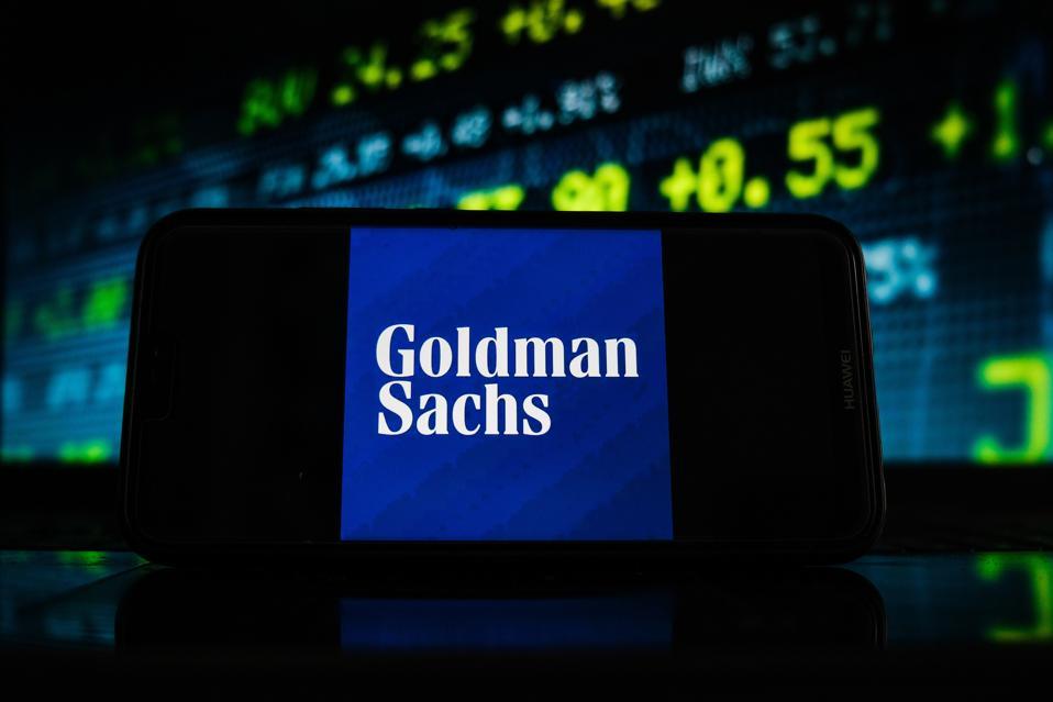 In this photo illustration a Goldman Sachs logo seen...