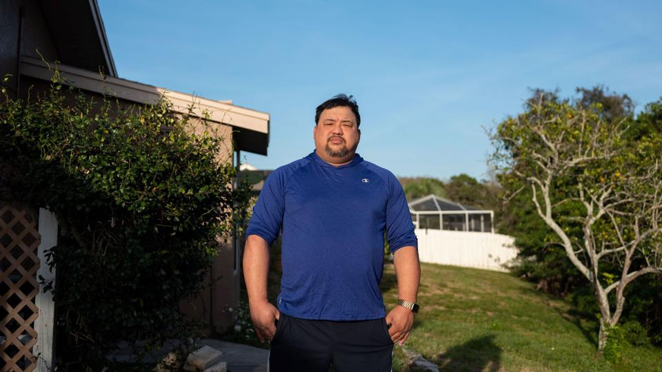 man stands in front of home in Florida
