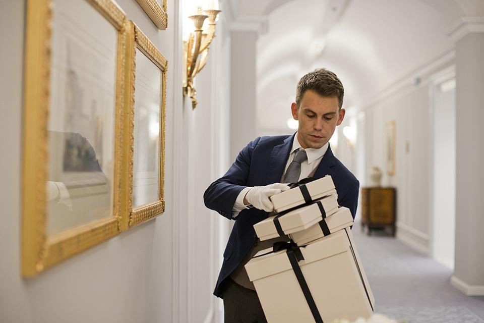 Butler holding gifts