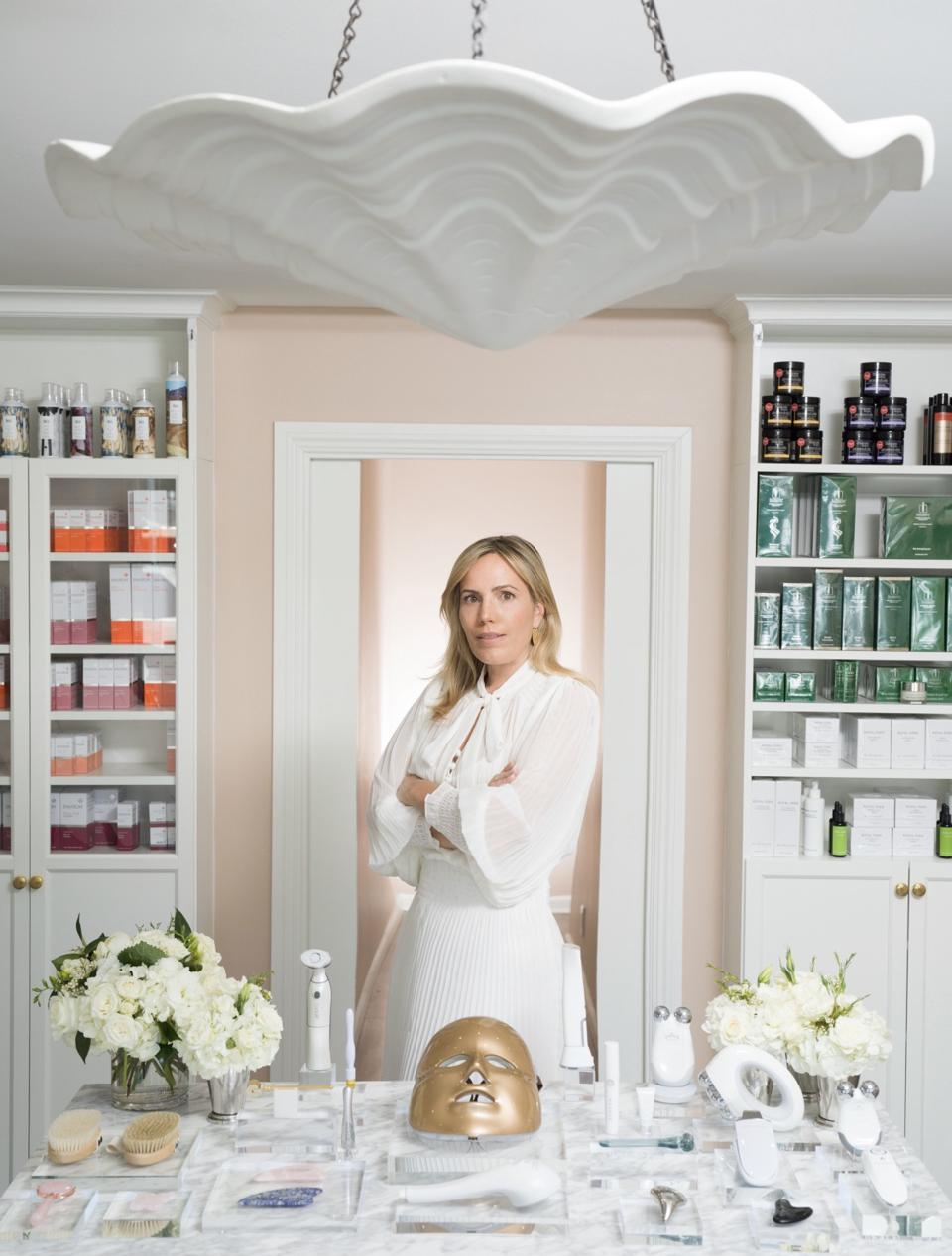 Knockout Beauty founder Cayli Cavaco Reck standing in her store/