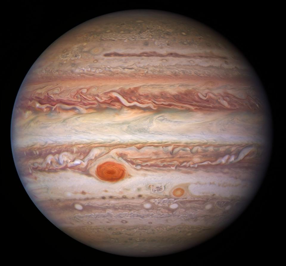 This visible-light image of Jupiter was created from data captured on 11 January 2017 using the Wide Field Camera 3 on the Hubble Space Telescope. Near the top, a long brown feature called a 'brown barge' extends 72,000 kilometers (nearly 45,000 miles) in the east-west direction. The Great Red Spot stands out prominently in the lower left, while the smaller feature nicknamed Red Spot Jr. (known to Jovian scientists as Oval BA) appears to its lower right.