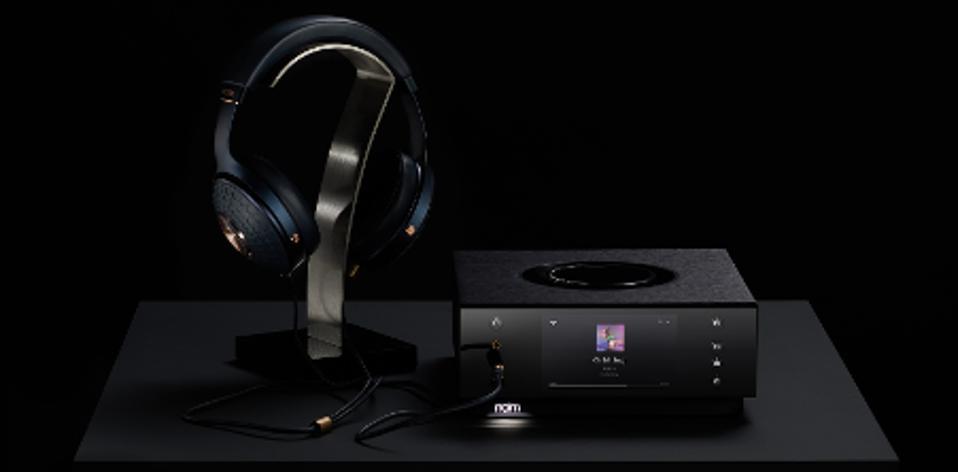 Naim Uniti Atom Headphone Edition next to a pair of Focal headphones
