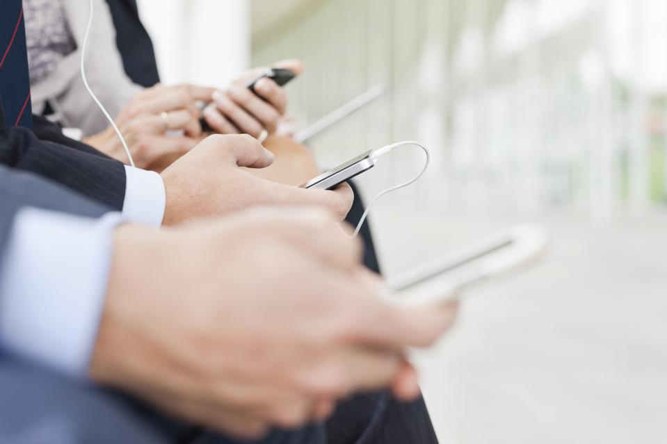 Business people texting on cell phones