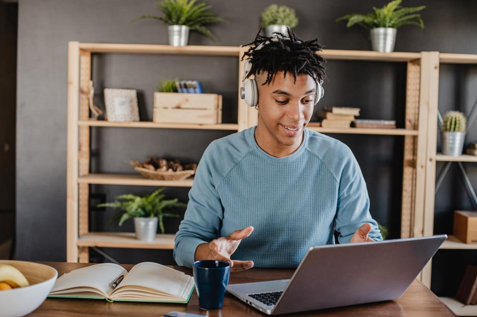 Young African American man is working from home