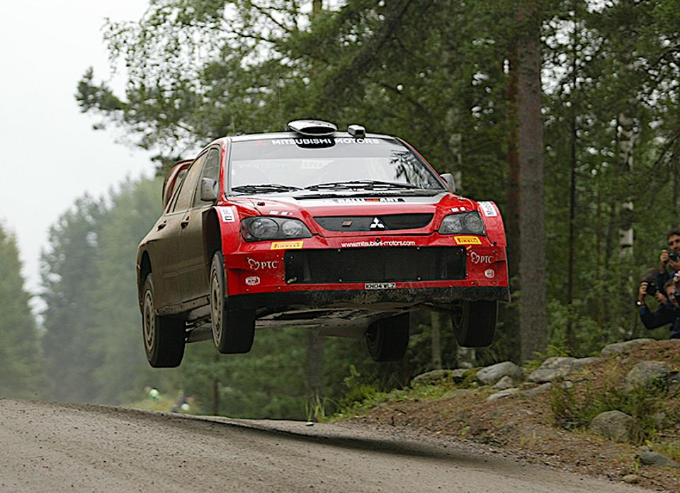 Cars can fly: The last Lancer Evolution-based World Rally Championship car before the firm withdrew from WRC in 2005.