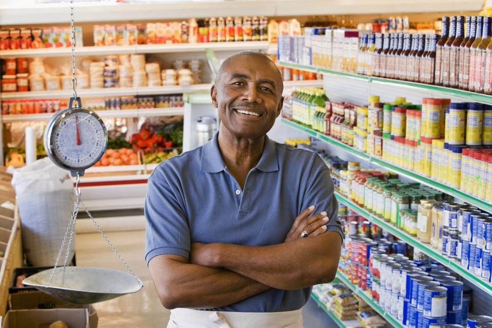 Senior man in grocery store  smiling, portrait