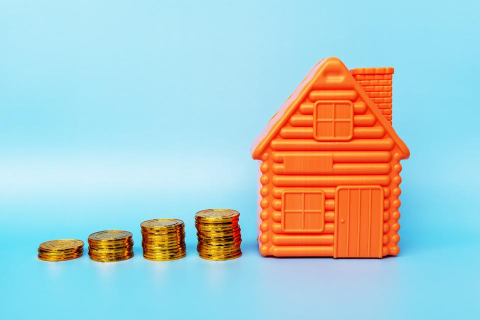 House Model and Stack of Coins