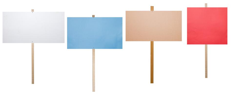 4 blank protest signs of different colors on white background