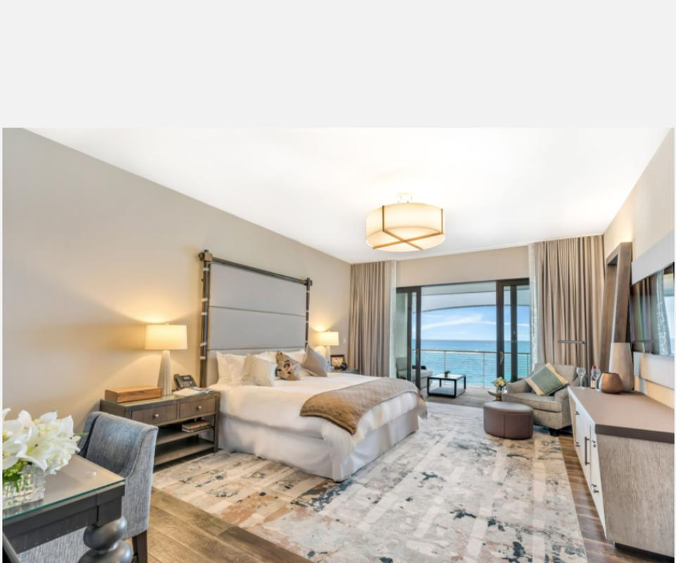 King-sized room overlooking the ocean at the Loren at Pink Beach
