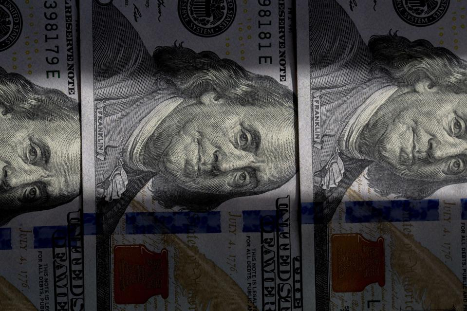 Banknotes of US Dollar are arranged for photography.