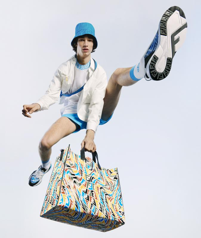 a model jumps in brightly-colored activewear