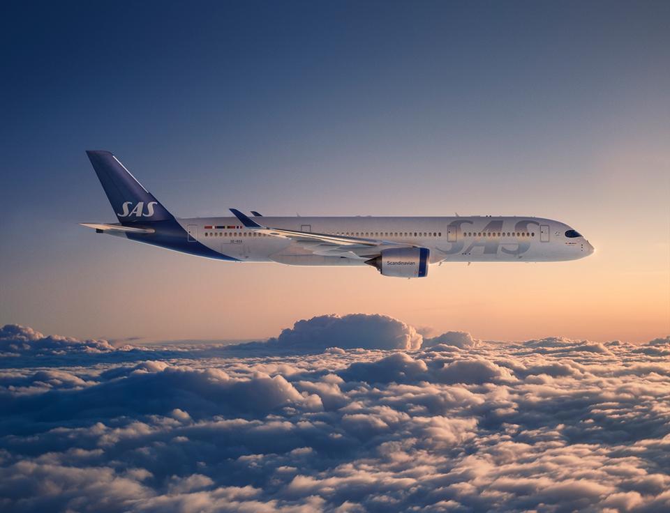 SAS plane cloudscape at sunrise.