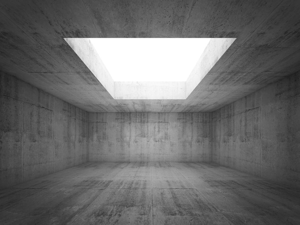 Empty dark concrete room interior with white opening in ceiling,