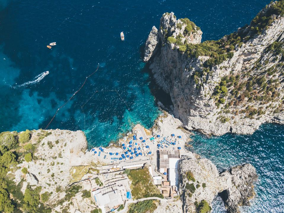 Aerial view of beach and cliff in Capri Island.