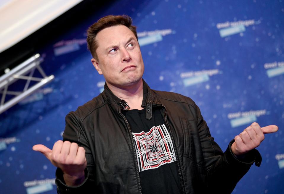 Elon Musk raises a quizzical eyebrow on receiving the Axel Springer Award In Berlin.