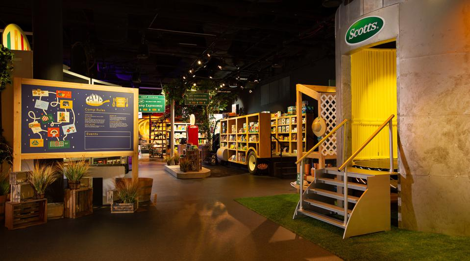 Separate room inside a Camp store with a Scotts-related display. Kids have to climb five steps to get there.