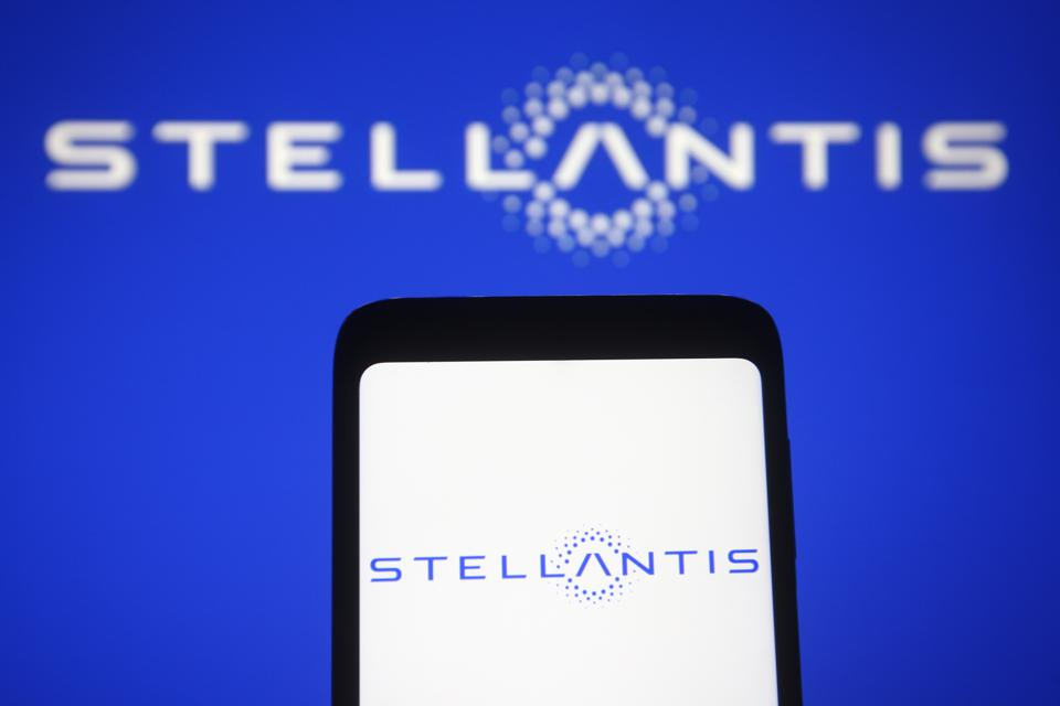 In this photo illustration a Stellantis logo of a...
