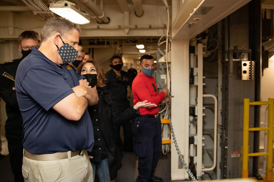 Acting Navy Undersecretary James F. Geurts stares down one of USS Ford's elevators.