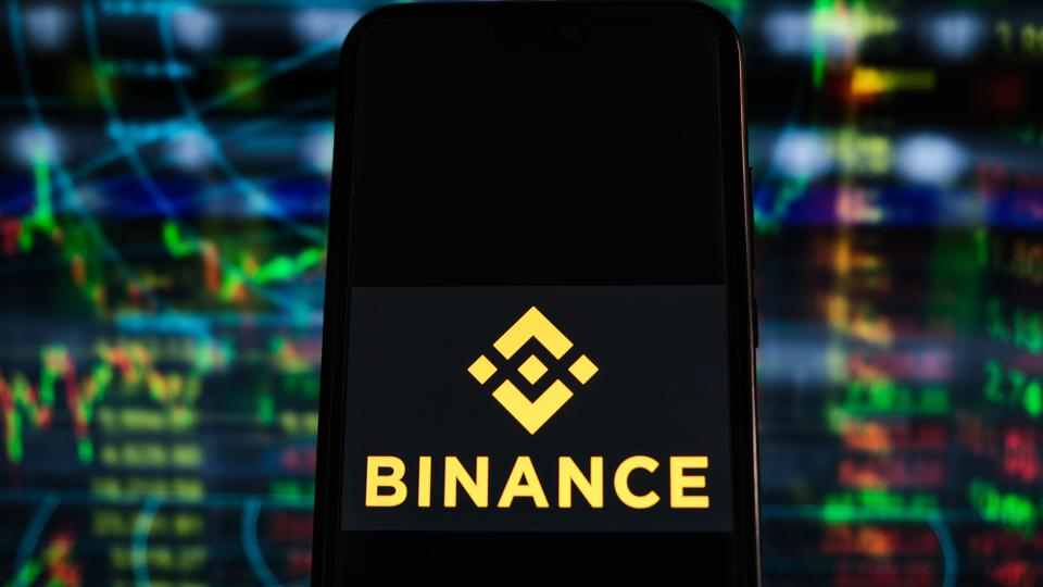 In this photo illustration a Binance logo seen displayed on...