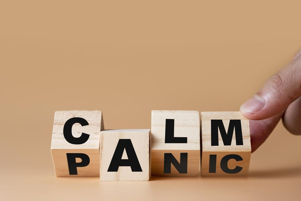 Hand flipping wooden cubes for change wording″ Panic ″  to ″ Calm″.  Mindset is important for human development.