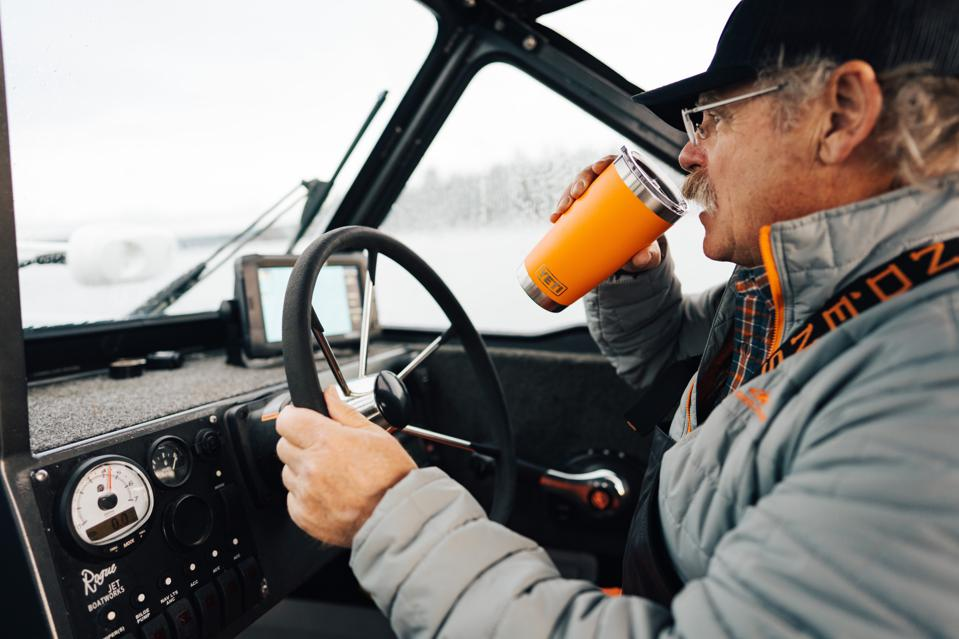 man drinking from YETI rambler
