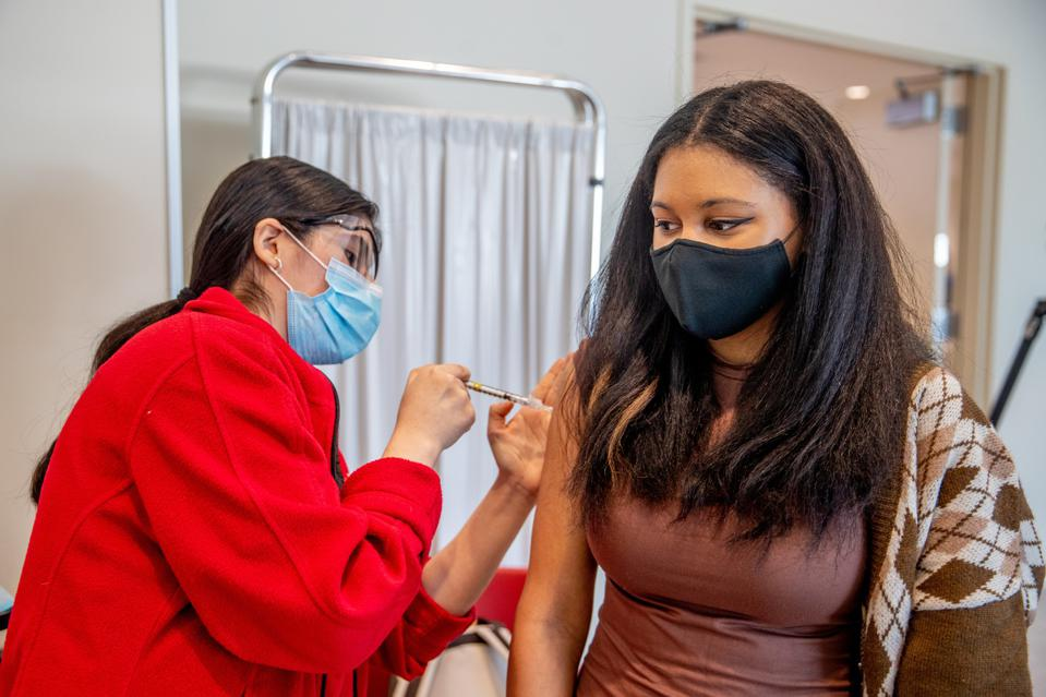 College student is vaccinated against Covid-19