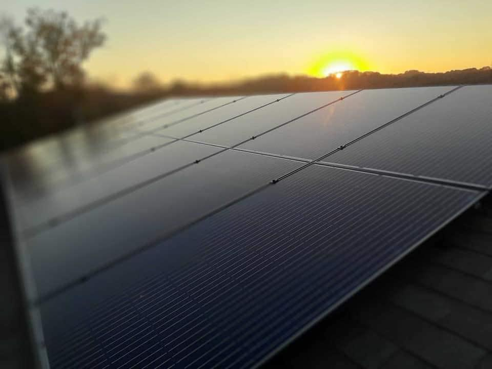 Revolt Energy's solar panels highlighted in the sunset.