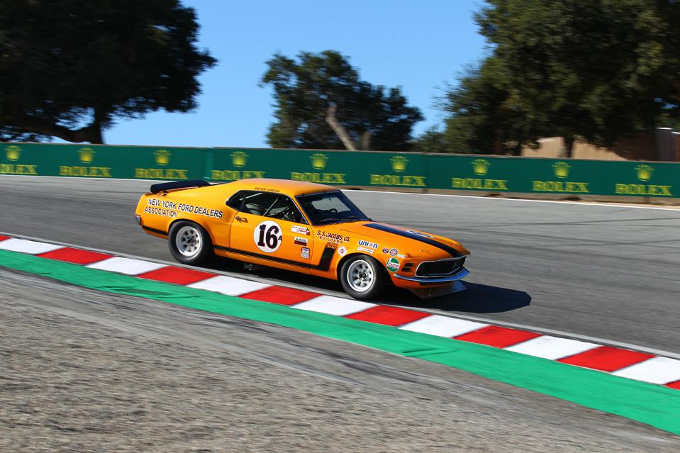 Ford Mustang Boss 302 descends down the Corkscrew at Rolex Monterey Motorsports Reunion.