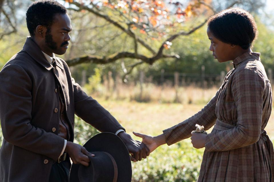 Royal (William Jackson Harper) and Cora (Thuso Mbedu) hold hands in underground railroad